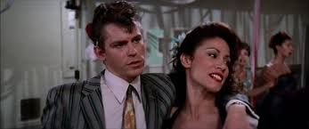 Jeff Conaway as Kenickie and Annette Charles as Cha Cha