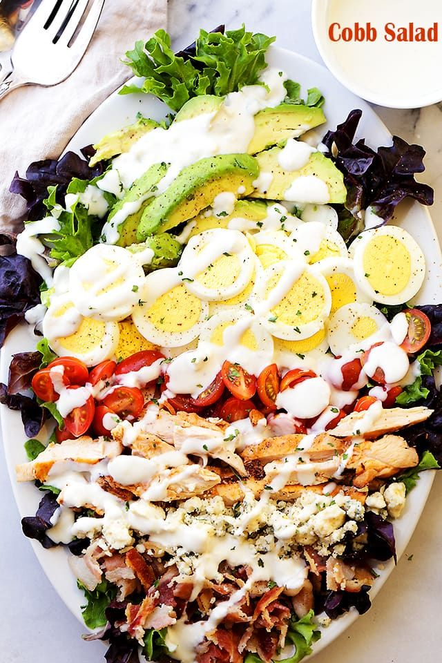 Cobb Salad - This classic American main-dish salad is packed with chicken, avocado, tomatoes, bacon, blue cheese and eggs, all topped with a lightened-up blue cheese dressing.