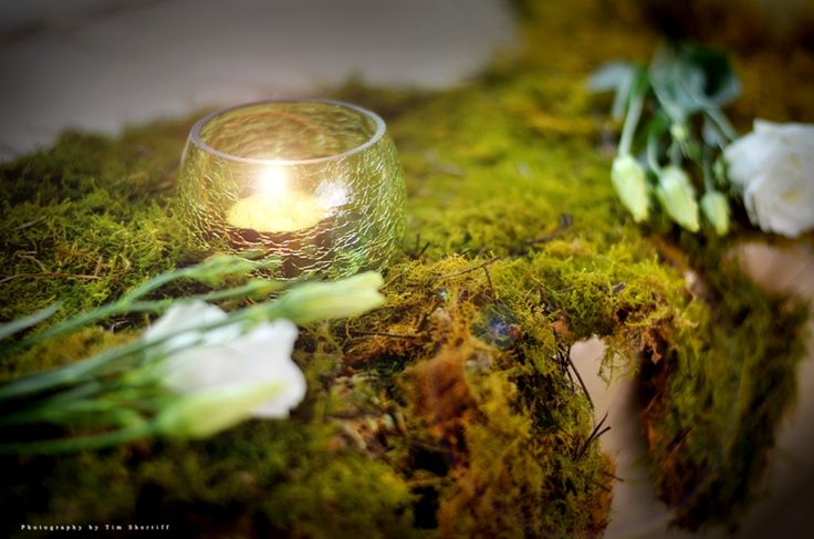 Our favourite #events are those with an #EnchantedGarden theme, and this was one of those.  #Moss covered tables were the perfect shade of #greenery and were embellished with flowers and candles.  Divine!    You can see more of this wedding on our website here:  http://www.sugarandspiceevents.com.au/weddings/real-weddings/lisa-nathan/