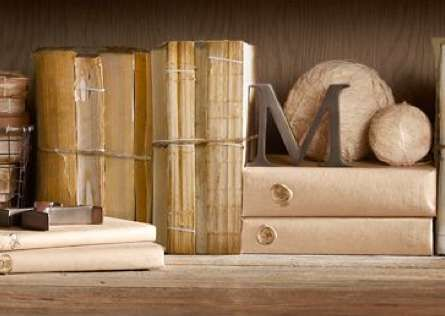 Restoration Hardware Cover less Book bundles. DIY - a nice way to save and display books that would otherwise be trashed.