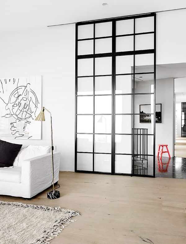 sliding door to separate the kitchen and living room.  dump the baby gate.