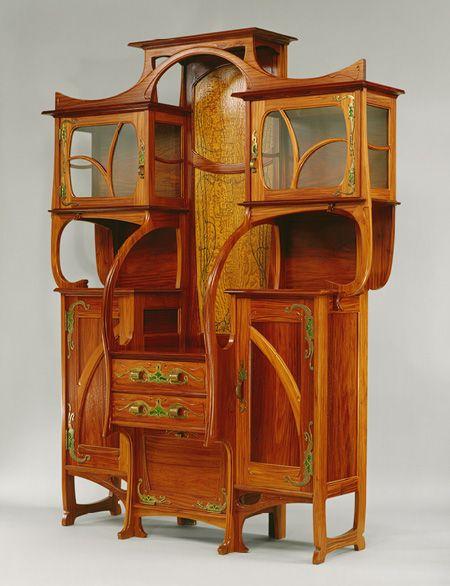Gustave Serrurier-Bovy (Belgian, 1858–1910). Cabinet-vitrine, 1899. Red narra wood, ash, copper, enamel, glass.