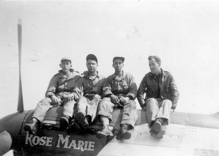 "Lt. Eugene W James. 328th Fighter Squadron. P-51D 44-14207 PE-E_ ""Rose Marie"" (L) ""The Kelly Kid 2"" (R). Seen here on the cowling are from L-R Cpl. Lane, armorer; Sgt. Hardig, a.c.c.; S/Sgt. Marinello, c.c. and pilot Lt. James."