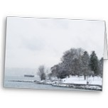 Gorgeous view of English Bay in the winter in lovely muted tones of light blues and greys. Room for logo at the top.