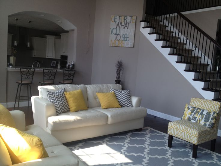 yellow and gray living room trellis rug chevron pillows trellis