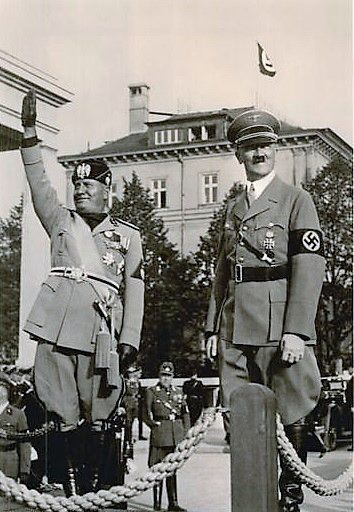 Hitler and Mussolini standing by the Braunes Haus in Munich. Theirs was a fascinating relationship and one of genuine regard on both sides. Hitler really liked Mussolini and vice versa. Even when the Italians proved to utterly worthless as allies, Hitler continued to make excuses. Italian participation on the Eastern front was a disaster. The Alpini Corps was decimated at Nikolayevka. The Red Army versus Italian troops on home soil was like shooting fish in a barrel. (via putschgirl)