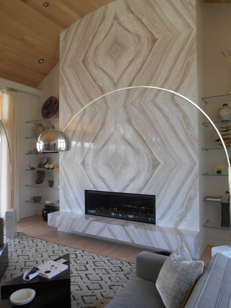 This magnificent linear fireplace is surrounded by meticulously book-matched marble.