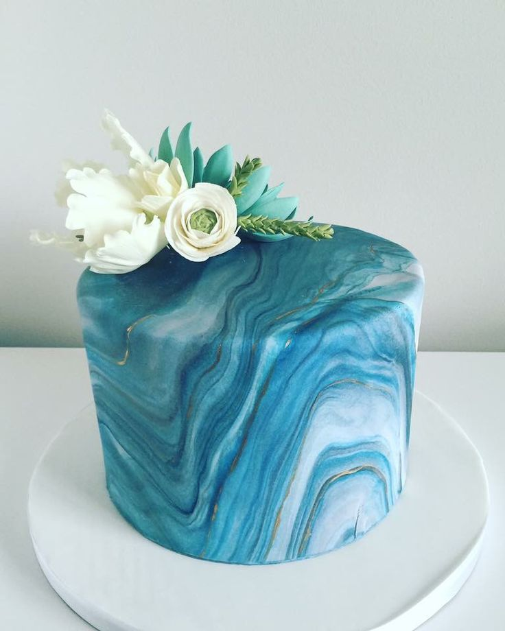Guy's birthday cake or cake for a man.  Marbled fondant cake accented with sugar flowers that include succulent and parrot tulip.  Cake created by www.lanasdoughdelights.com