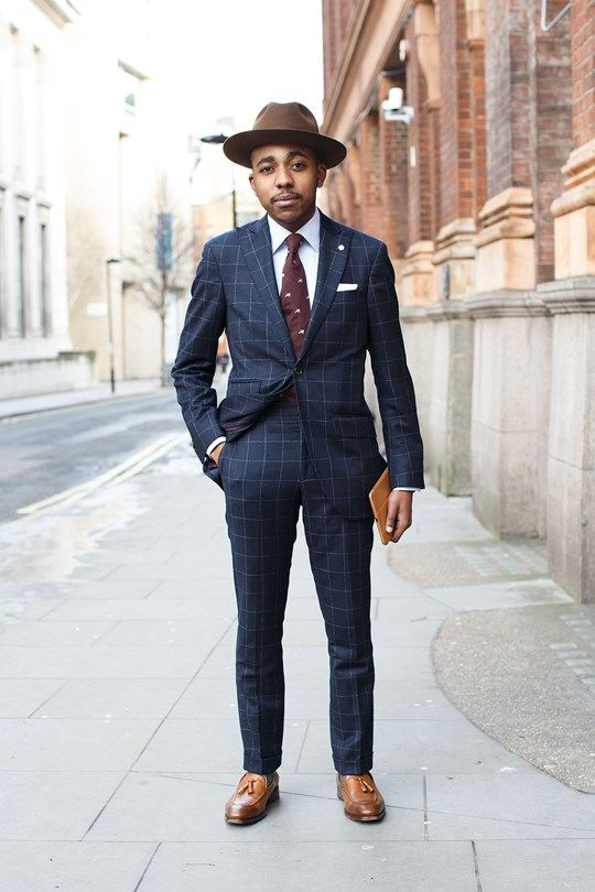 Nigel Runwende, tailor:  Hackett suit and tie, Emmett London shirt; Lock and Co hat and Reiss shoes.