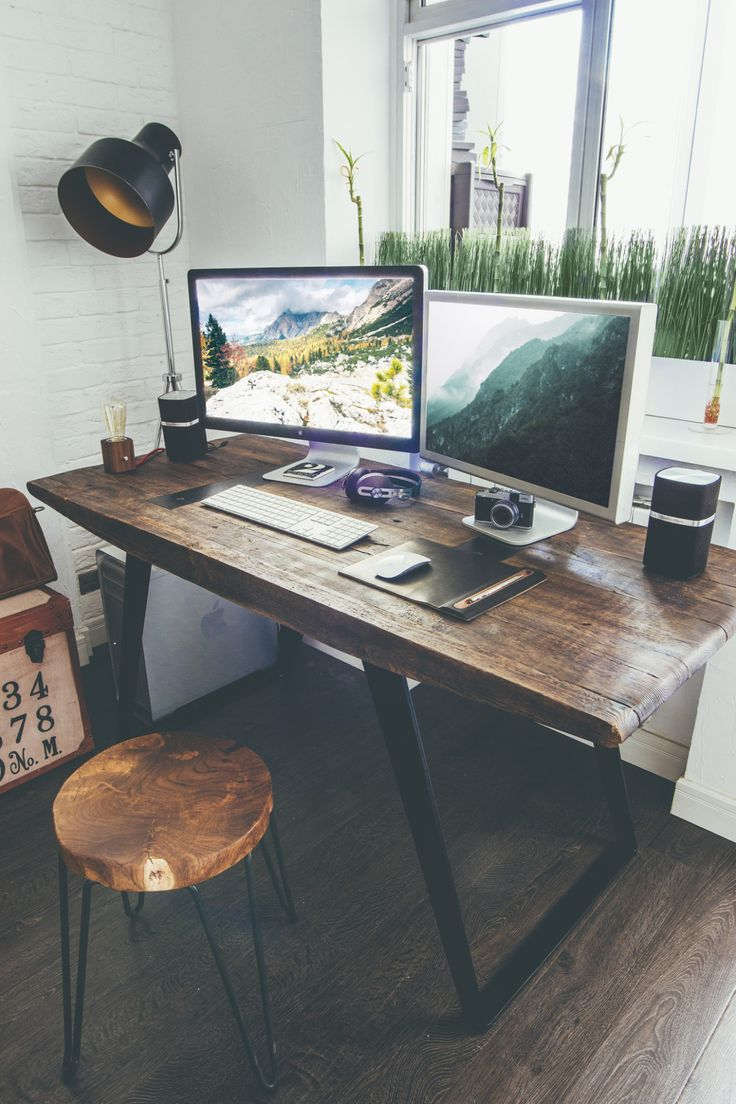 Rustic wood desk with wide workspace in studio office.