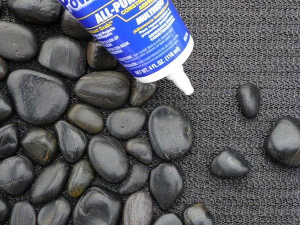 Cool doormat made with smooth flat rocks.