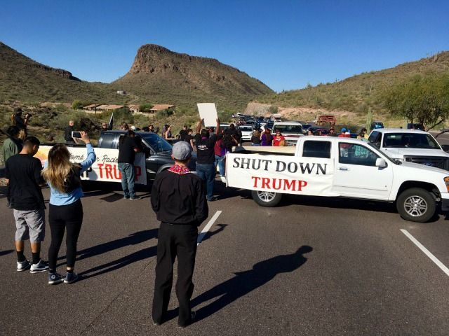 Hundreds of cars were forced to make a U-turn less than threemiles from a Donald Trump rally today after protesters parked in the highway to block Trump supporters from reaching the event.