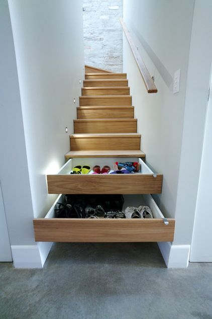 This narrow stairway features a truly ingenious storage solution: two of the risers are fitted with drawers to make a pile of shoes disappear.
