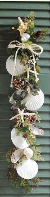 beach Christmas swag/ use ready made pine swag, add shells and raffia ties. would paint all shells with FOLK ART PEARL WHITE.