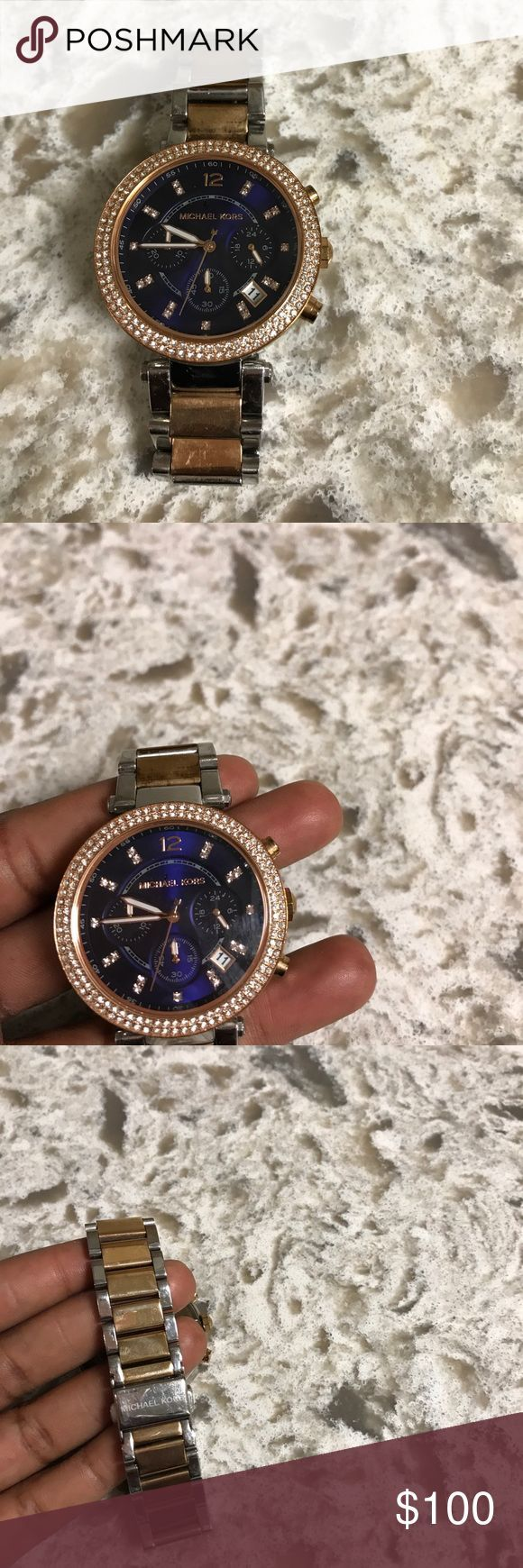 Michael Kors MK6141 Watch Two tone rose gold and silver watch with a Navy blue face and beveled rim and hour markers.  Stainless steel case; chronograph; and luminous hands. Accessories Watches