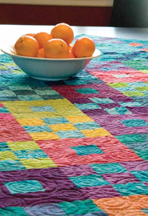 Free Tropical Fruits lap quilt pattern designed by Sarah Maxwell and Dolores Smith, an easy batik quilt pattern from McCall's Quilting magazine.