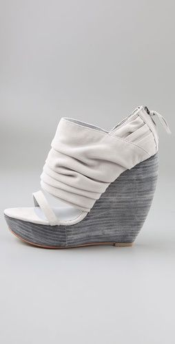 Can anyone tell me who makes this Wedge shoe? I really want them!
