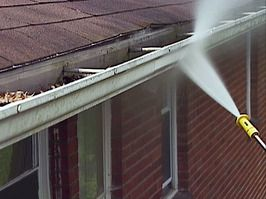 cleaning gutters with water pressure