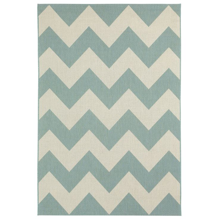 outdoor patio rug! the chevron is a fun pattern and the blue complements the orange browns of the house's exterior