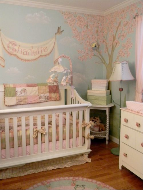 Great nursery walls! Birdhouses nailed to the wall, bunnies and wildlife painted around the room!