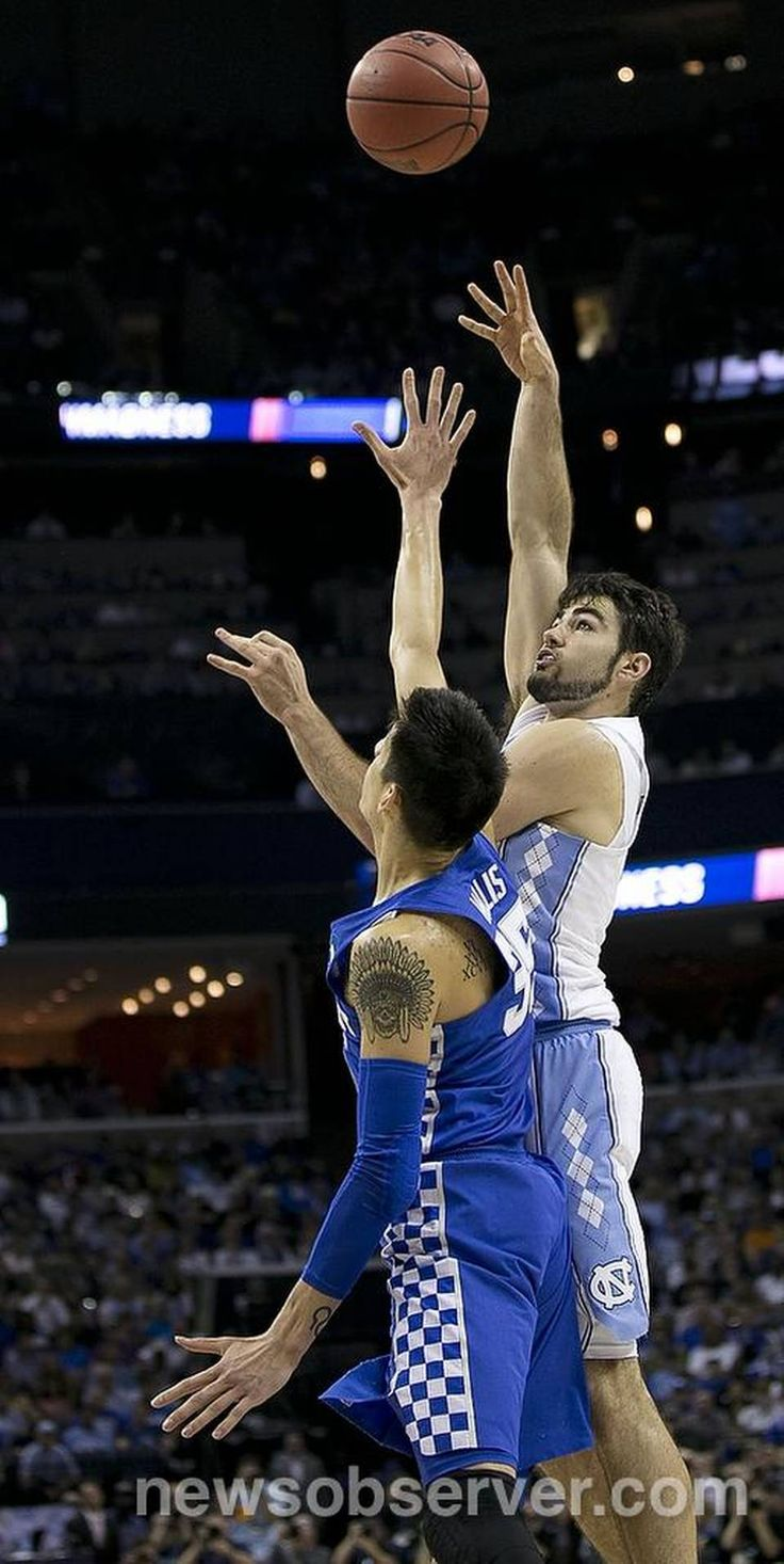 North Carolina's Luke Maye (32) puts up a shot over Kentucky' s Derek Willis (35) during the first half of the NCAA South Regional Final on Sunday, March 26, 2017 at FedExForum in Memphis, TN.