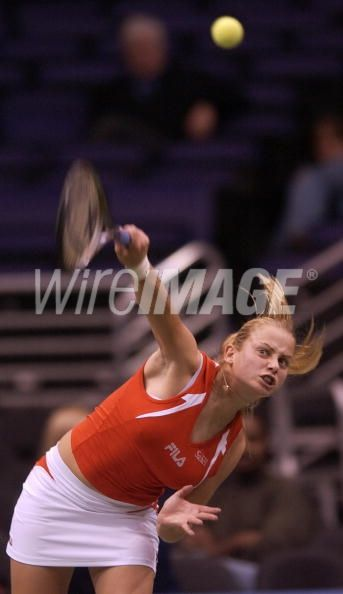Jelena Dokic of Yugoslavia serves...