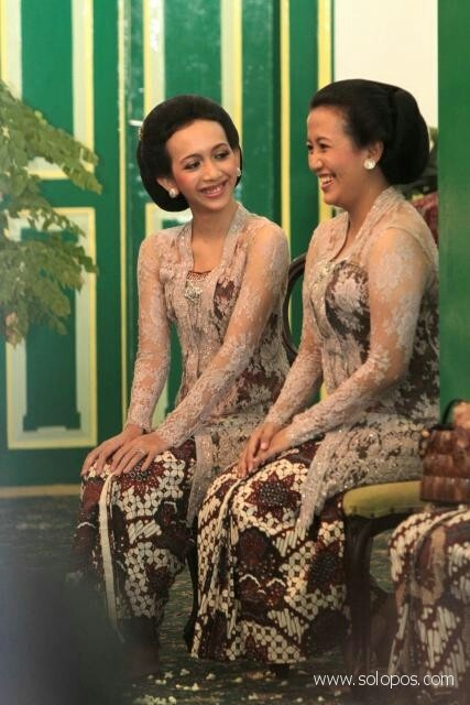 Two Princesses of the Royal Court of Yogyakarta Indonesia, the daughters of the present Sultan (the reigning King), killing the time chatting
