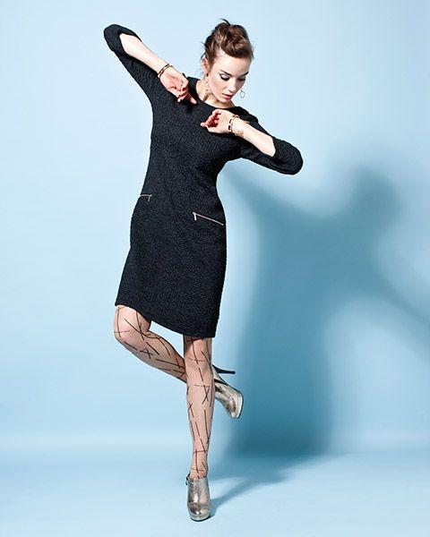 Upea musta mekko, jossa yksityiskohtana kiinnostuksen herättävät vetoketjutaskut.