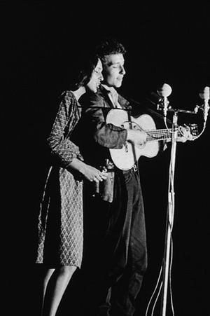 Joan Baez and Bob Dylan perform together onstage, 1963