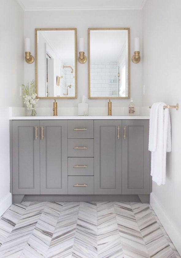Elements of Style--how gorgeous is this?  love the herring bone honed marble floor, the paint color and the brass touches!