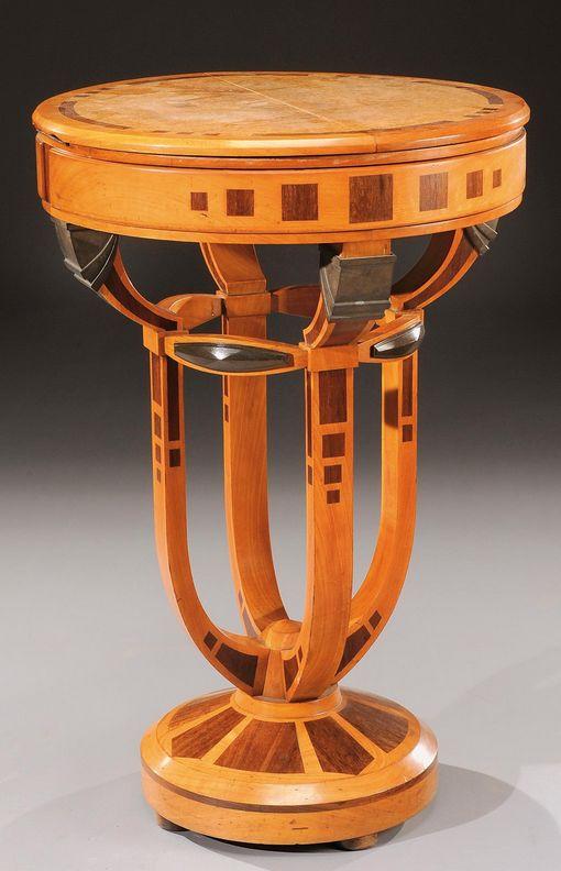 Art Deco Belgian pedestal table in mahogany and exotic wood veneer with a circular top. Circa 1930. H : 29 ½ Diam : 19 2/3 in.