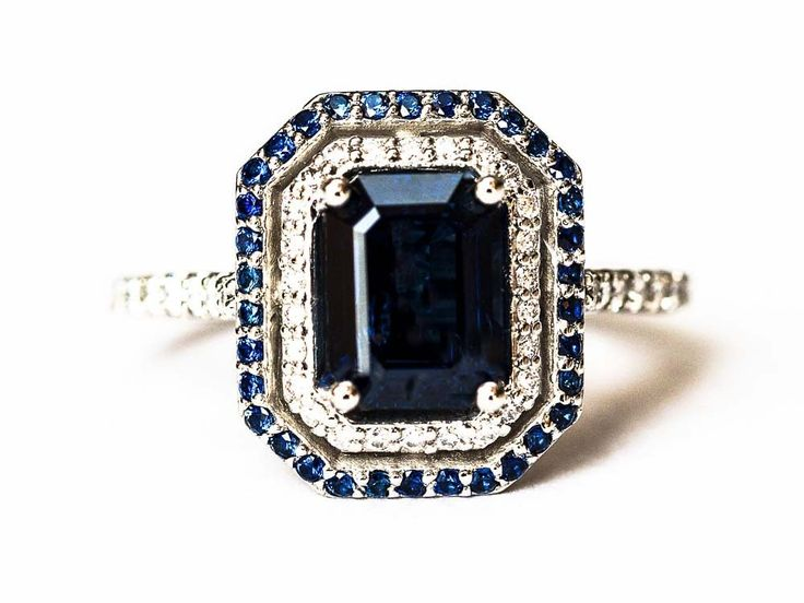 - AA sapphire - Emerald cut - 8mm x 6mm (1.75 ct) - 68 accent diamonds and sapphires, 1 - 1.3mm (.25 ctw) - G and SI quality diamonds - Platinum - New - Free shipping worldwide - Third party appraisal