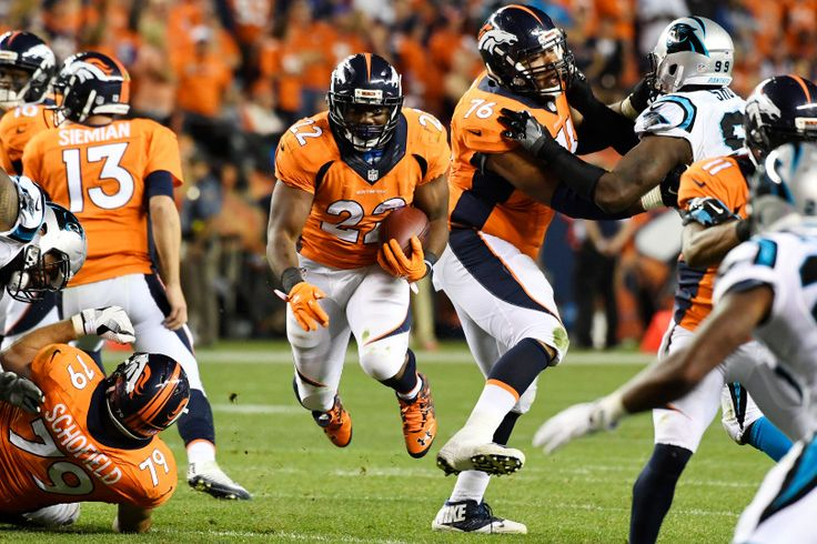 Running back C.J. Anderson (22) of the Denver Broncos runs against the Carolina…