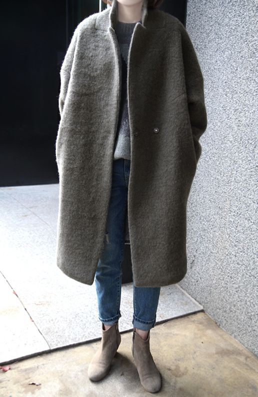 boots + jeans (rolled up) + sweater (half tucked) + long coat (or jacket)