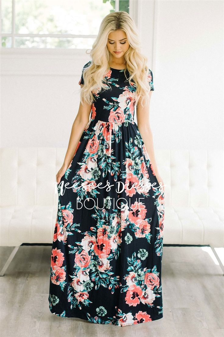 Our super soft floral dresses just got a make over! Now coming in floor length, this maxi dress is as pretty and comfortable as they come! Navy maxi dress features a pink, black and mint watercolor floral print, elastic waist, short sleeves and pockets!