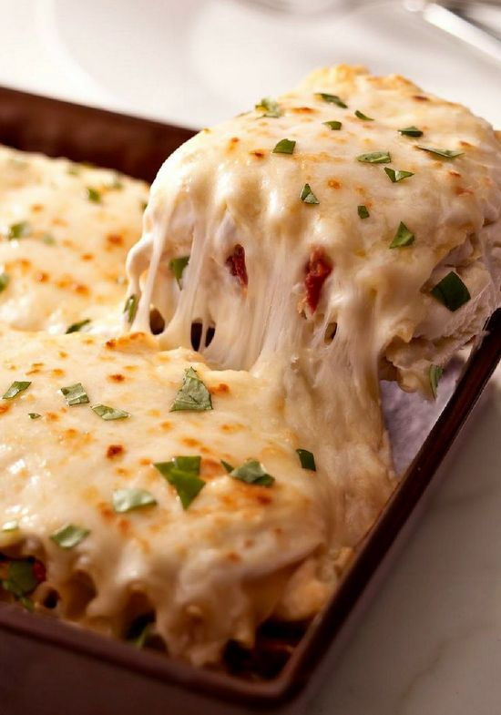 Creamy White Chicken & Artichoke Lasagna with shredded chicken, sun-dried tomatoes and artichokes in a rich, creamy white sauce