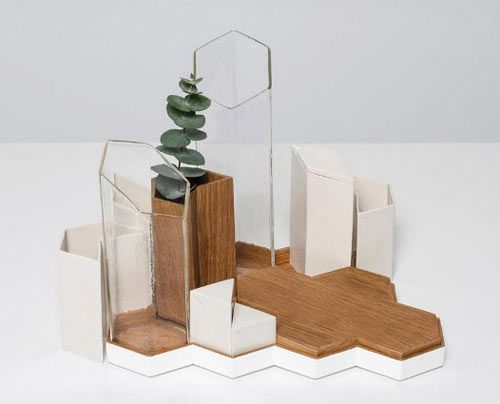 The Grid Set by Valvanera Arrieta is not only dynamic, it's functional because the set contains 11 pieces that any table could use including: salt shaker, pepper shaker, oil bottle, vinegar bottle, vase, napkin and cutlery containers, trays and pitchers.