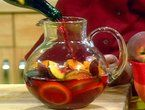 Sunset Sangria with pomegranates, pears, star fruit, brandy... Bobby Flay recipe