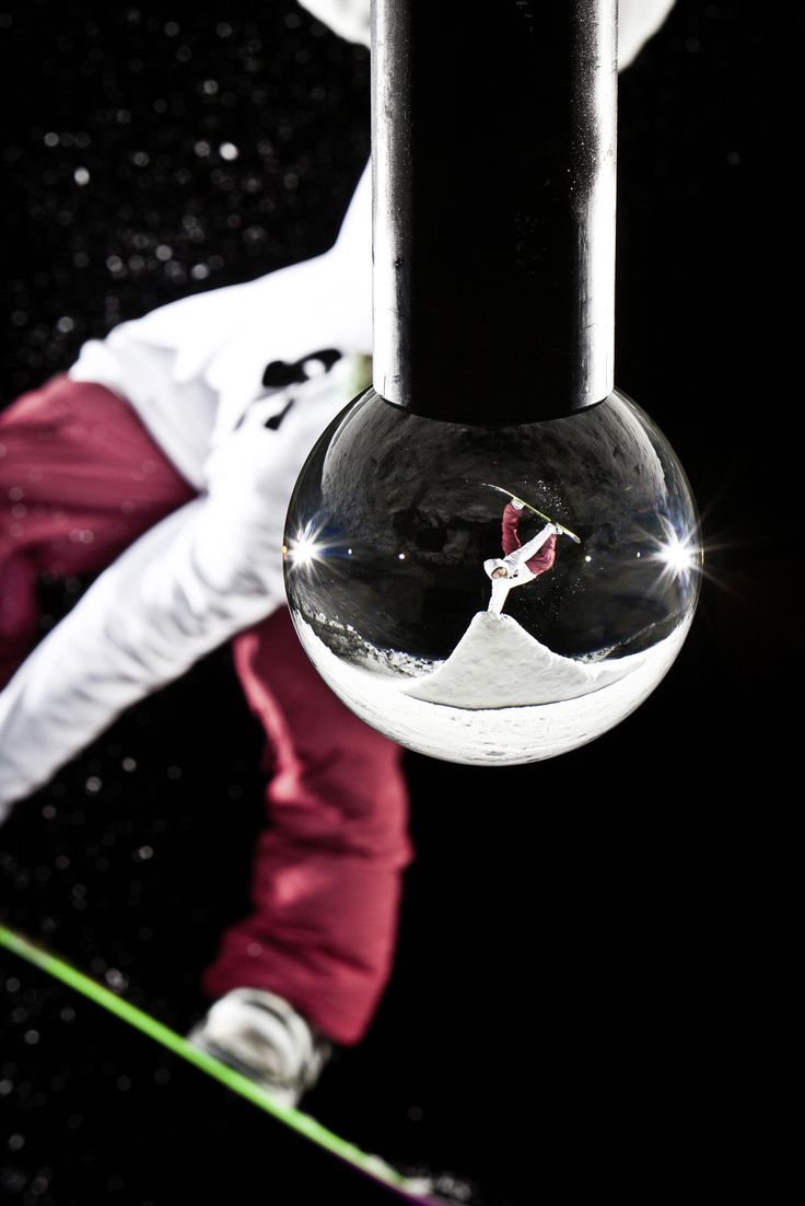 Photo by Claudio Casanova  Snowboarder Philipp Schicker photographed through a 10kg crystal ball in Oberiberg, Switzerland.