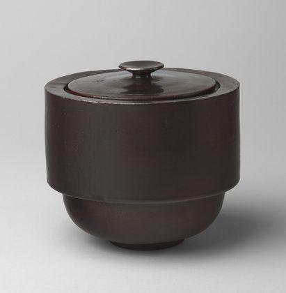 "Kitchen Storage Pot  Theodor Bogler (German, 1897–1968)    1923. Slip-cast earthenware with metallic glaze, .a (body): 5 1/4 x 6 3/4"" (13.3 x 17.1 cm) .b (lid): 1 3/8 x 5 1/4"" (3.5 x 13.3 cm). Manufactured by Bauhaus Ceramic Workshops, Weimar, Germany. Estée and Joseph Lauder Design Fund"