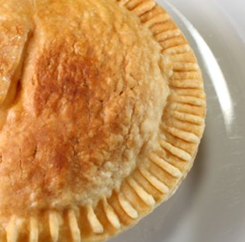 Easy Chicken Pot Pie Recipe:  1 can Campbell's Cream of Chicken Soup  1 (9 ounce) package frozen mixed vegetables, thawed  1 cup cubed precooked chicken (canned chicken will do)  1/2 cup of milk  2 thawed premade pie crusts
