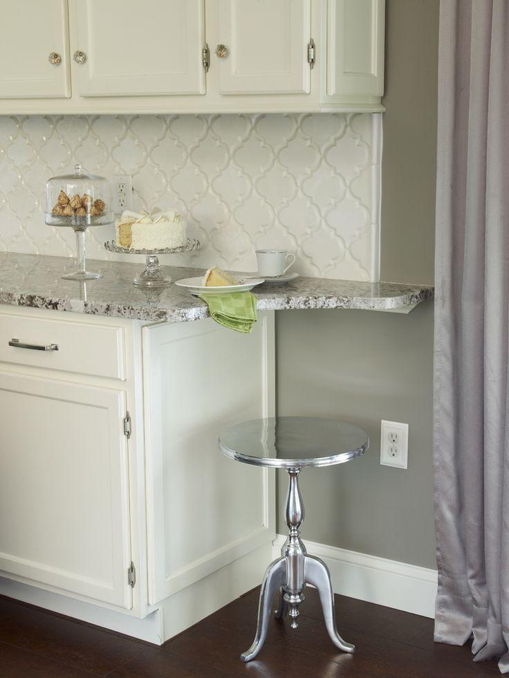 Bianco Antico Granite Countertop with White Cabinets ...