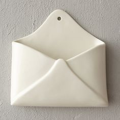 """Handmade in Italy from glazed ceramic, this wall-mounted letter holder is the perfect place to keep correspondence organized.- Ceramic- Hanging hardware not included- Handmade in Italy7.25""""H, 8""""W, 2""""D"""