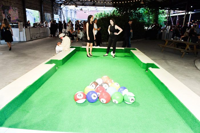 <p> A larger-than-life pool table mimicked a game of soccer, one of England's top sports.</p>