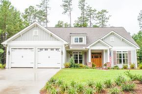 This beautiful traditional style home offers 3 large bedrooms, a flex space, 2 full baths, large open living space, and large rear porch. The great room has a gas fireplace, raised ceilings, and views
