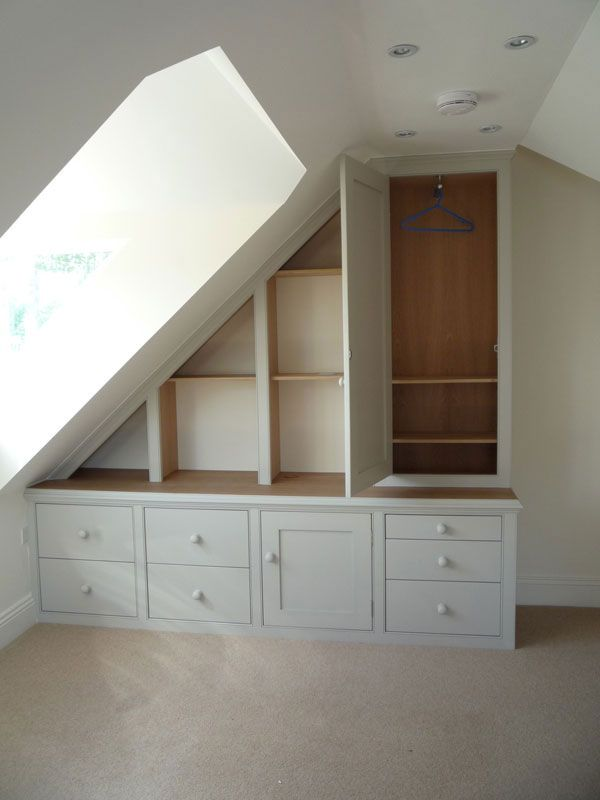 When a room has a dual purpose,  bedroom and home office - tick! Our handmade cupboards, filing drawers and mini wardrobe under the eaves has solved the storage problem!