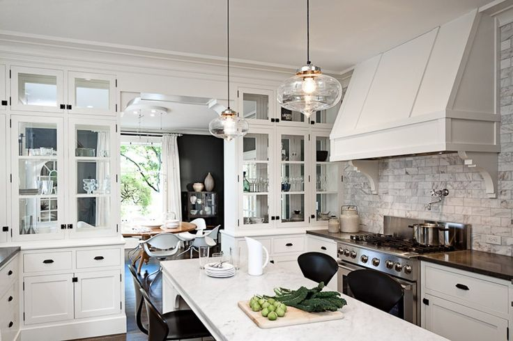 Interior. double glass  pendant lights over white kitchen island connecetd by white wooden hood and white brick wall. Contemporary  Pendant Lights For Kitchen Islands To Bright Your Dream Kitchen