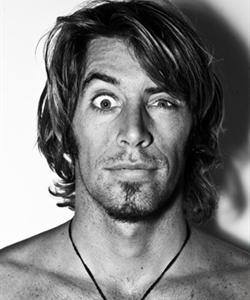 Dave Rastovich. A looker and surfer, as well as interesting, resourceful, and a do-gooder... and he makes funny faces. :)