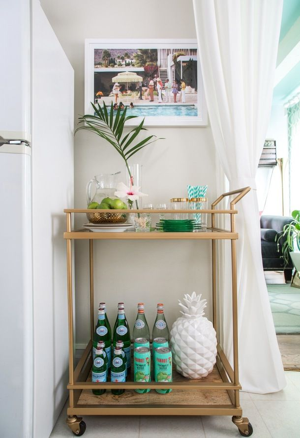 Style Your Bar Cart for the Season: Stock up on citrus, striped paper straws, colorful cocktail napkins, and those kitschy little drink umbrellas that transport you to a tropical island.