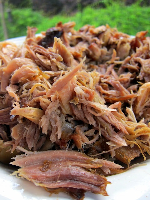 Slow cooker Kalua pulled pork. Three ingredients. Lots of compliments.  Used pork shoulder and drained in a colander before serving.